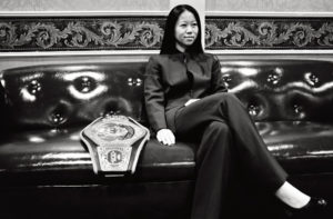 Christina Kwan - Champion Boxer in a suit with Championship Belt