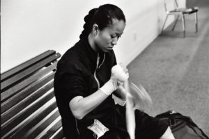 Christina Kwan - Champion Boxer wrapping hands.
